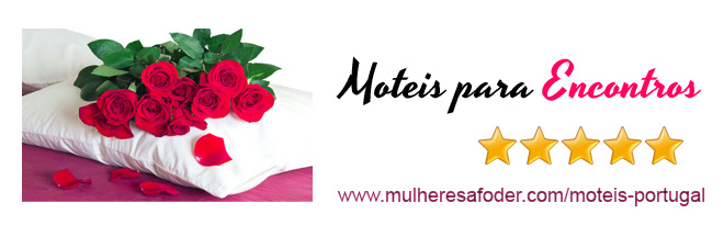 Moteis Portugal - Cama do motel com travesseiro e rosas vermelhas